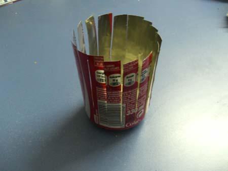 lata de cocacola cortada para reciclarla
