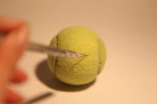 cara de nuestro monedero con pelota de tenis